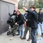 Aaron Wiederspahn, cinematographer Christoph Lanzenberg, and crew prepare during the shoot