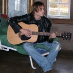 Ian Somerhalder practicing guitar on set